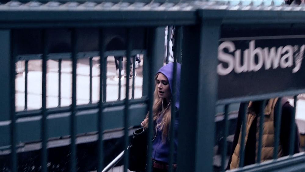 Woman boarding subway