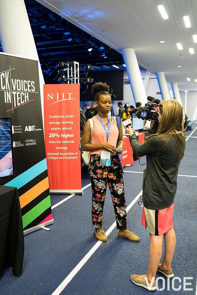 Reporter interviewing young woman