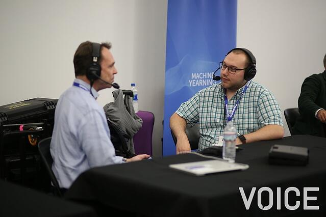 Podcaster interviewing man