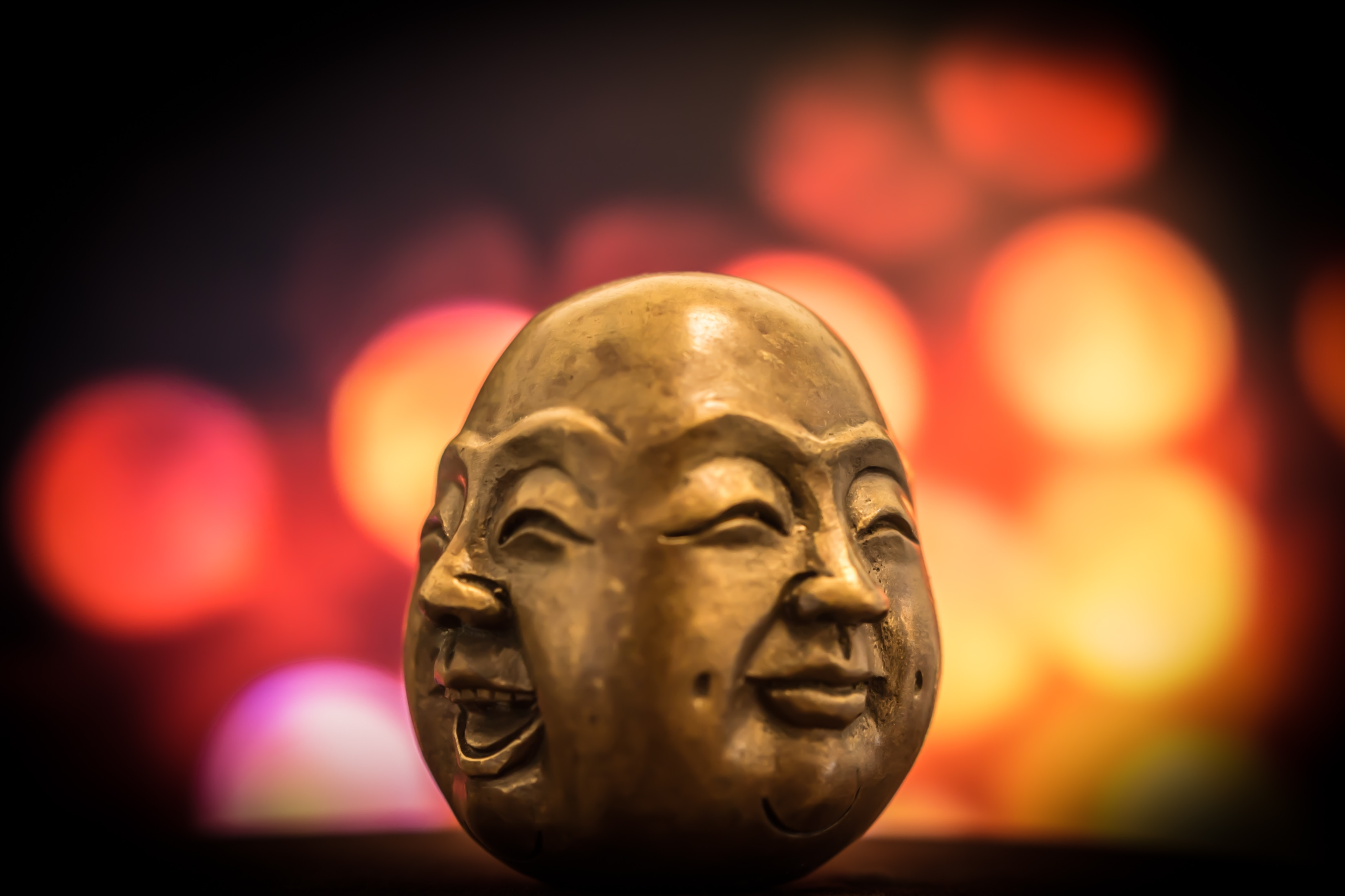 Buddha faces with happy expressions